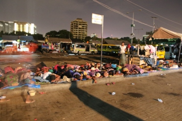 Head porters sleeping on the streets in Accra, Ghana country visit April 2018. © Anna Bulman 2018