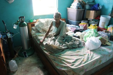 An elderly woman surviving on oxygen with no electricity in Puerto Rico, USA visit December 2017. © Anna Bulman 2017